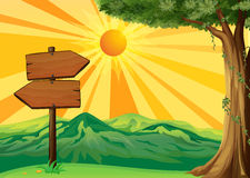 A wooden signboard with a view of the sunset Stock Photo