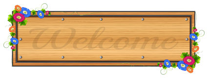 A wooden signboard with a welcome label Stock Photo