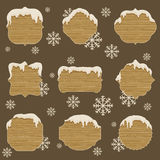 Wooden signboards in differen shapes with melting snow Royalty Free Stock Photography