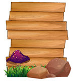 Wooden signboards with a mushroom and rocks at the bottom Royalty Free Stock Photography