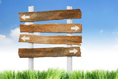 Wooden signpost. On blue sky stock photo