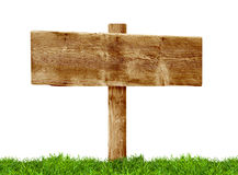 Wooden Signpost. On green grass on white Stock Photography