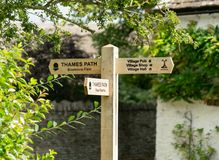 Wooden signpost along the Thames Path stock photo