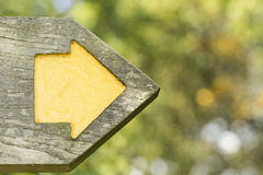 Wooden signpost with an arrow showing a direction Stock Images