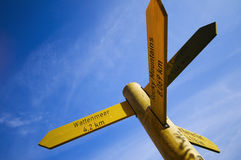 Wooden signpost on blue sky Royalty Free Stock Photo