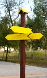 Wooden signpost of bright yellow color decorative Stock Image