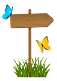 Wooden signpost with butterflies Royalty Free Stock Photos