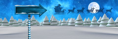 Wooden signpost in Christmas Winter landscape and Santa's sleigh and reindeer's. Digital composite of Wooden signpost in Christmas Winter landscape and Santa's Stock Photo