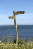 Wooden signpost on a coastal path Royalty Free Stock Image