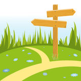 Wooden signpost at crossroads. Wooden pointer arrow at crossroads on green flower meadow. Vector illustration Royalty Free Stock Photos