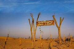A wooden signpost at the entrance of Love Lake Dubai stock photography