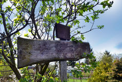 Wooden signpost in the garden, add Stock Photos