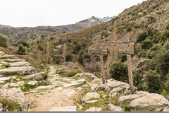 Wooden signpost giving directions on a hiking trail in Corsica Royalty Free Stock Images