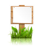 Wooden signpost with grass paper and reflection on white Royalty Free Stock Photos