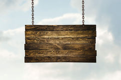 Wooden signpost hanging on chains Royalty Free Stock Photography