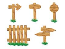 Wooden signpost standing in grass set isolated Stock Photo