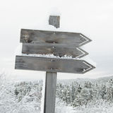 Wooden signpost. In winter landscape Stock Photography