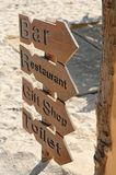 Wooden Signs. Four wooden signs on sand Royalty Free Stock Photography