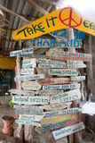 Wooden signs in beach bar with distances to destinations all aro Royalty Free Stock Photo