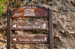 Wooden signs. Inside the natural reserve of the necropolis Pantalica, Sicily stock image