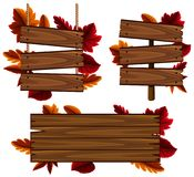 Wooden signs with leaves in background Royalty Free Stock Image
