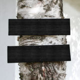 Wooden Signs on a Tree. Blank Black Wooden Signs on a Tree stock photography