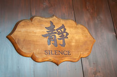 Wooden 'silence' sign in English and Chinese Royalty Free Stock Images