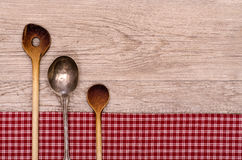 Wooden and silver spoon with text space Stock Images