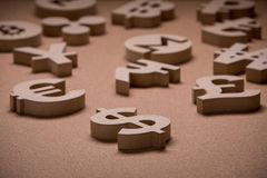 Wooden Sings or Symbols of World Currencies in Group Picture royalty free stock photography