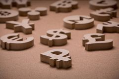 Wooden Sings or Symbols of World Currencies in Group Picture stock images