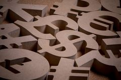 Wooden Sings or Symbols of World Currencies in Group Picture stock photos