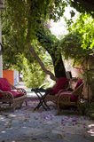 Wooden sitting place green garden in the small hotel  ,bodrum Stock Photos