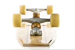 Wooden skate board on back on white Royalty Free Stock Photography