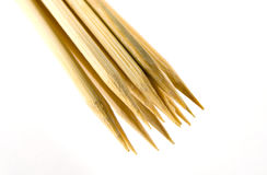Wooden Skewers. Closeup of wooden skewers on a white background Royalty Free Stock Image