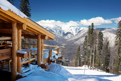 Wooden ski chalet in snow. Mountain view stock images