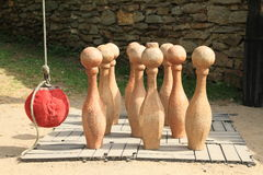 Wooden skittles. Big wooden Russian skittles with red ball on rope on Velhartice Castle in Czech Republic Royalty Free Stock Photos