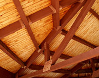 Wooden Slat Ceiling. A richly colored wooden slat ceiling with exposed beams Royalty Free Stock Images