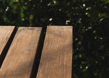 Wooden slats of a park bench Royalty Free Stock Images