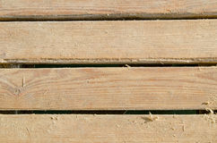Wooden Slats with some sand. Worn wooden planks with some sand on top Stock Photo