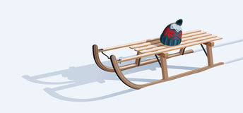 Wooden sled and hat on snow Stock Photos