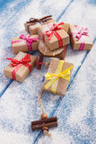 Wooden sled and wrapped gifts for Christmas or other celebration on snowy boards Royalty Free Stock Photos