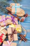 Wooden sled and wrapped gifts with ribbons for Christmas, spruce branches Royalty Free Stock Photos