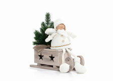 Wooden sledge with Christmas presents  isolated on white backgro Stock Photos
