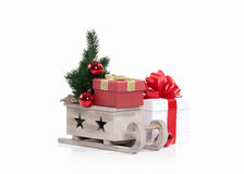 Wooden sledge with Christmas presents  isolated on white Royalty Free Stock Photo