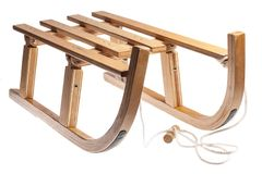 Wooden sledge. Color picture of a wooden sledge isolated on white Royalty Free Stock Image