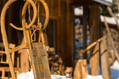 Wooden sledge outside winter cottage snow Royalty Free Stock Image