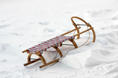 Wooden sledge on snow Stock Photo