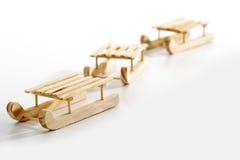 Wooden sledges on white background Royalty Free Stock Photos