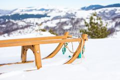 Wooden sleds on snow covered mountain Stock Photos