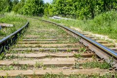 Wooden sleepers on the railway in the 20th century. Rails of sleepers Royalty Free Stock Photography